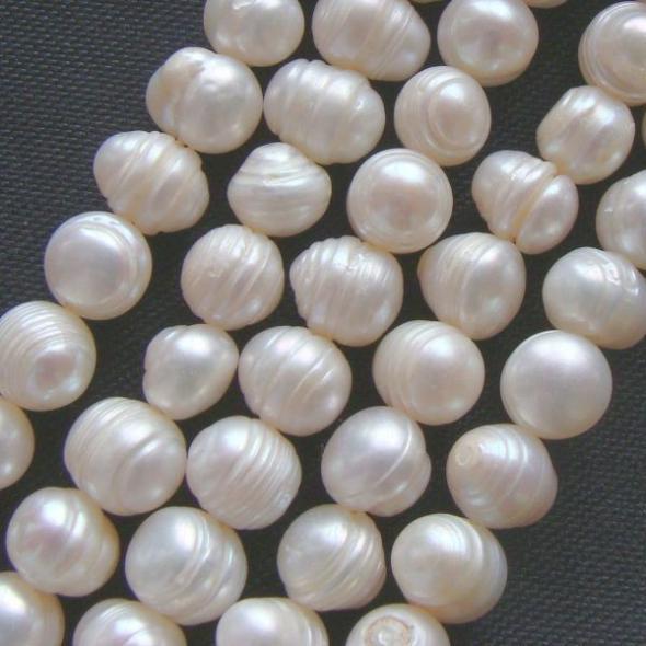 Margele perle de cultura  7*8mm albe ovale